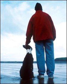 Man on beach with dog