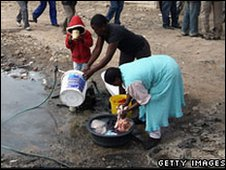 People getting water in Alexandra township (file photo)