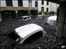 Cars lie buried in sludge in Funchal, Madeira, after the 20 February flood disaster