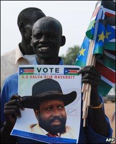 Man holding SPLM poster