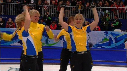 Sweden's women's curling team celebrate winning gold