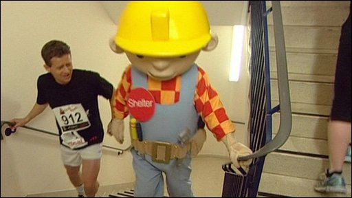 Mike Bushell runs up Tower 52 alongside Bob The Builder
