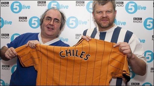 Danny Baker presents Adrian Chiles with his Shirt of Hurt.