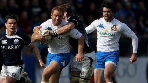 Gonzalo Garcia of Italy is tackled by John Barclay of Scotland