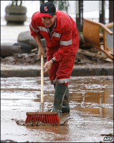 A man cleans up after flooding in Madeira, Portugal, last week