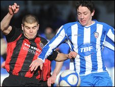 Conor Powell of Bohemians competes with Coleraine's Rory Patterson