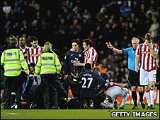 Arsenal midfielder Aaron Ramsey is stretchered off after suffering a serious injury against Stoke City