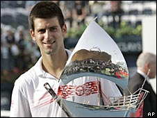 Novak Djokovic poses with the Dubai Open trophy