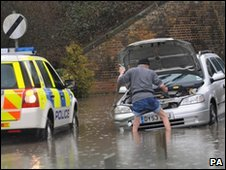 A driver in Essex is towed out of deep water by police