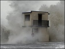 Waves hit the waterfront in Ver-sur-Mer village, western France. 28 Feb