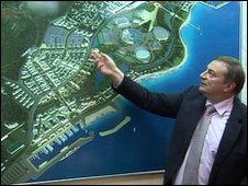 Sochi's mayor, Anatoly Pakhomov,  shows the layout of the Olympic park