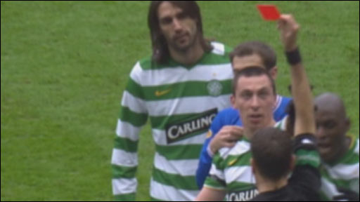 Celtic captain Scott Brown is shown a red card by referee Dougie McDonald