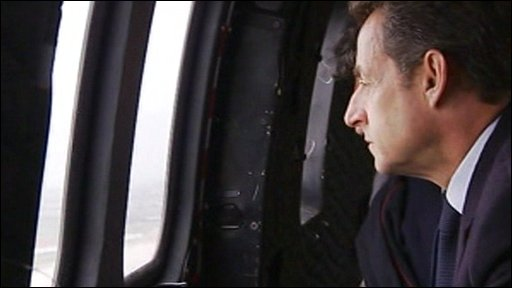 French President Nicolas Sarkozy views the storm damage from a helicopter