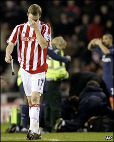 Ryan Shawcross leaves the field in tears