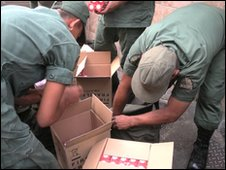 Venezuelan troops packing bulbs into knapsacks