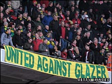 Man Utd fans display an anti-Glazers banner during the Carling Cup final