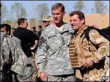NATO commander General Stanley McChrystal with an unidentified British soldier during a visit to Marjah, Helmand province 1 March 2010