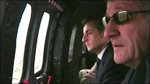 President Sarkozy (left) surveys damage in France