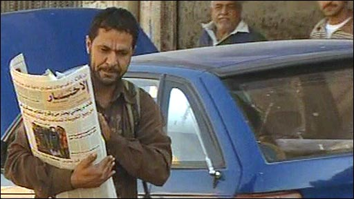 An Iraqi newspaper salesman