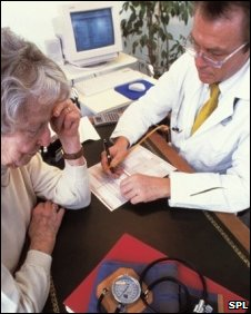 A GP discussing treatment with an elderly patient