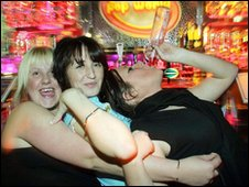 Revellers enjoy themselves in a bar in Newcastle