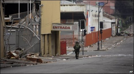Soldier patrols empty street in Concepcion during curfew - 2 March 2010