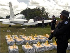 Guatemalan police guard 728kg of cocaine found inside a twin-angine light aircraft in Tiquisate, Escuintla, 160km (100 miles) south of Guatemala City - file image 11 August 2009