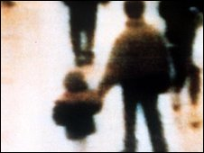 CCTV of James Bulger being led away by one of his killers