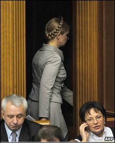 Ukraine's Prime Minister Yulia Tymoshenko leaves parliament after losing a confidence vote