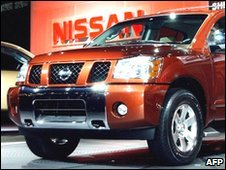 A red Nissan Pathfinder Armada