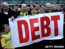 Manchester United fans protest against the Glazer family ownership of the club