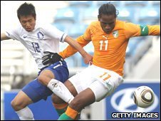 Ivory Coast's Didier Drogba (right) and South Korean Lee Young-Pyo