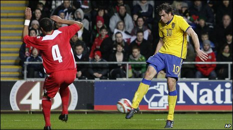 Bolton striker Johan Elmander fires Sweden ahead just before the break