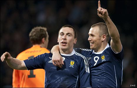 Scott Brown celebrates his goal with Kenny Miller