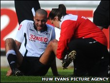 Darren Pratley receives treatment before being forced off injured