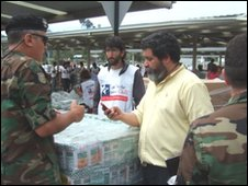 Aid distribution is co-ordinated from the car park of a shopping mall in Concepcion
