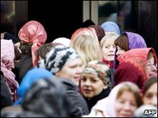 Dutch protesters wear headscarves in an anti-Wilders demonstration