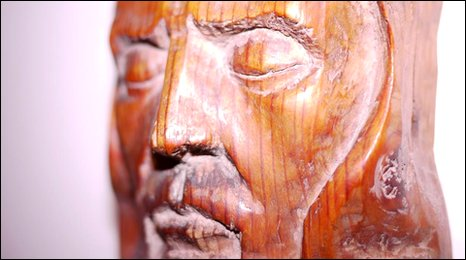 The face of Jesus carved from wood