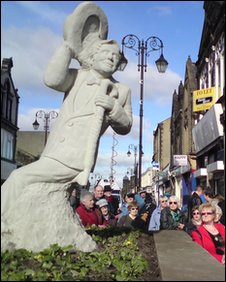 Morley people look at the statue of Ernie Wise