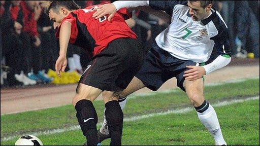 Niall McGinn puts Albania's Ansi Agoli under pressure in Tirana