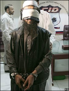 Blindfolded alleged Taliban commander Abu Waqas is presented before reporters in Karachi. Photo: February 2010
