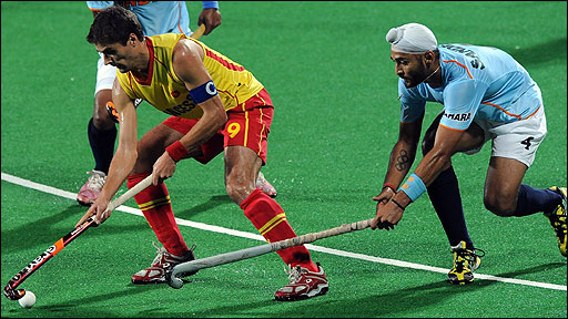 Spanish hockey player Pol Amat (L) and Indian hockey player Sandeep Singh vie for the ball during their World Cup 2010 match