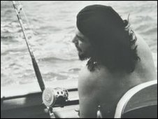 Che Guevara on boat with fishing rod