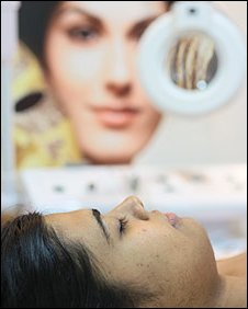 Indian woman receiving skin lightening treatment
