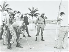 Fidel Castro playing golf