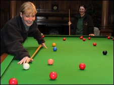 Katherine Williamson playing billiards at Cragside Hall