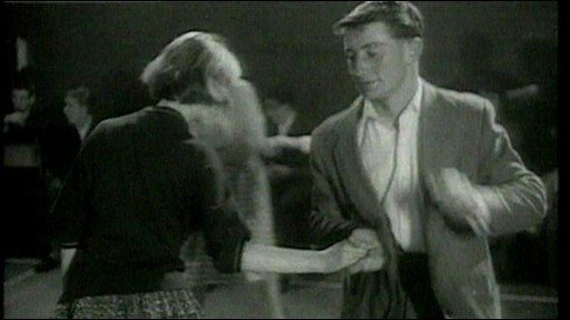 Young people dancing in the 60s