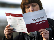 A woman reads a pamphlet about the referendum