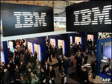 Visitors walk around the IBM stand