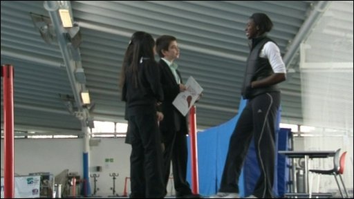 Three school reporters interviewing Christine Ohuruogu